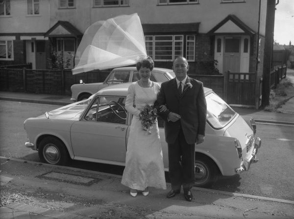 A bride and her father, 1960s