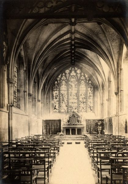 Shows high arches, stained glass windows and altar. Photographic Collection West Sussex Record Office, Ref No PH/26113/92