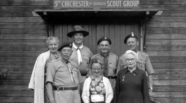 Group of scout leaders posing outside the scout hut, 30 January 1962 Chichester Photographic Collection West Sussex Record Office Ref No: CPS 1296/10