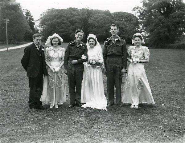 Wedding party at Ebernoe, Sussex. Groom and Best Man in army uniform, 10 May 1947 George Garland Collection West Sussex Record Office Ref No: Garland N28038