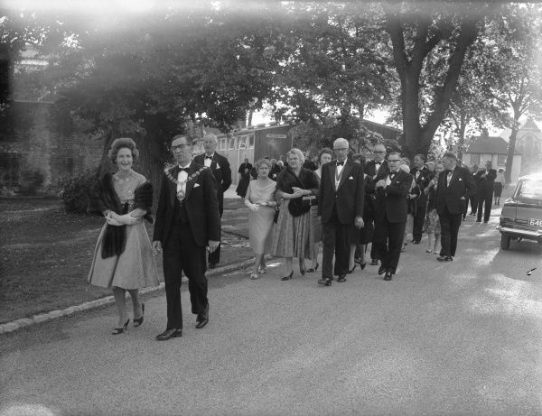 Leading civic dignitaries leaving the restaurant for the opening performance at the theatre, 5 July 1962 Chichester Photographic Collection West Sussex Record Office Ref No: CPS 1306/2